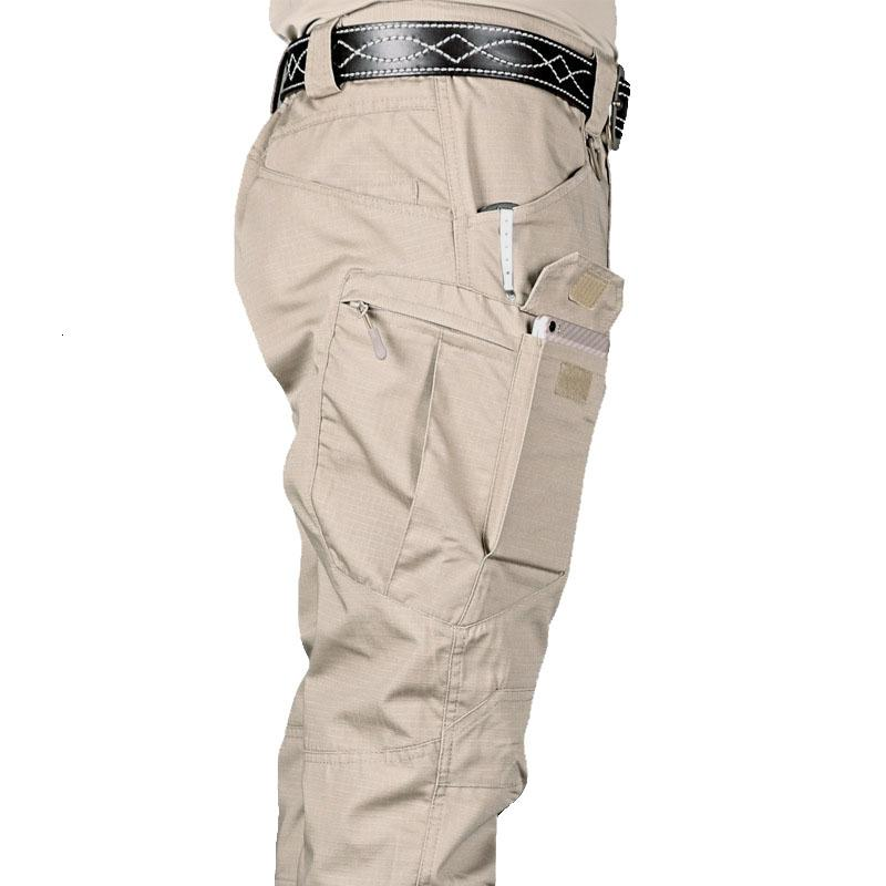 Los nuevos Mens tácticos pantalones múltiple Elasticidad de bolsillo militar conducción urbana Tacitcal Pantalones Hombres gordo delgado Pantalón cargo 5XL CJ191210