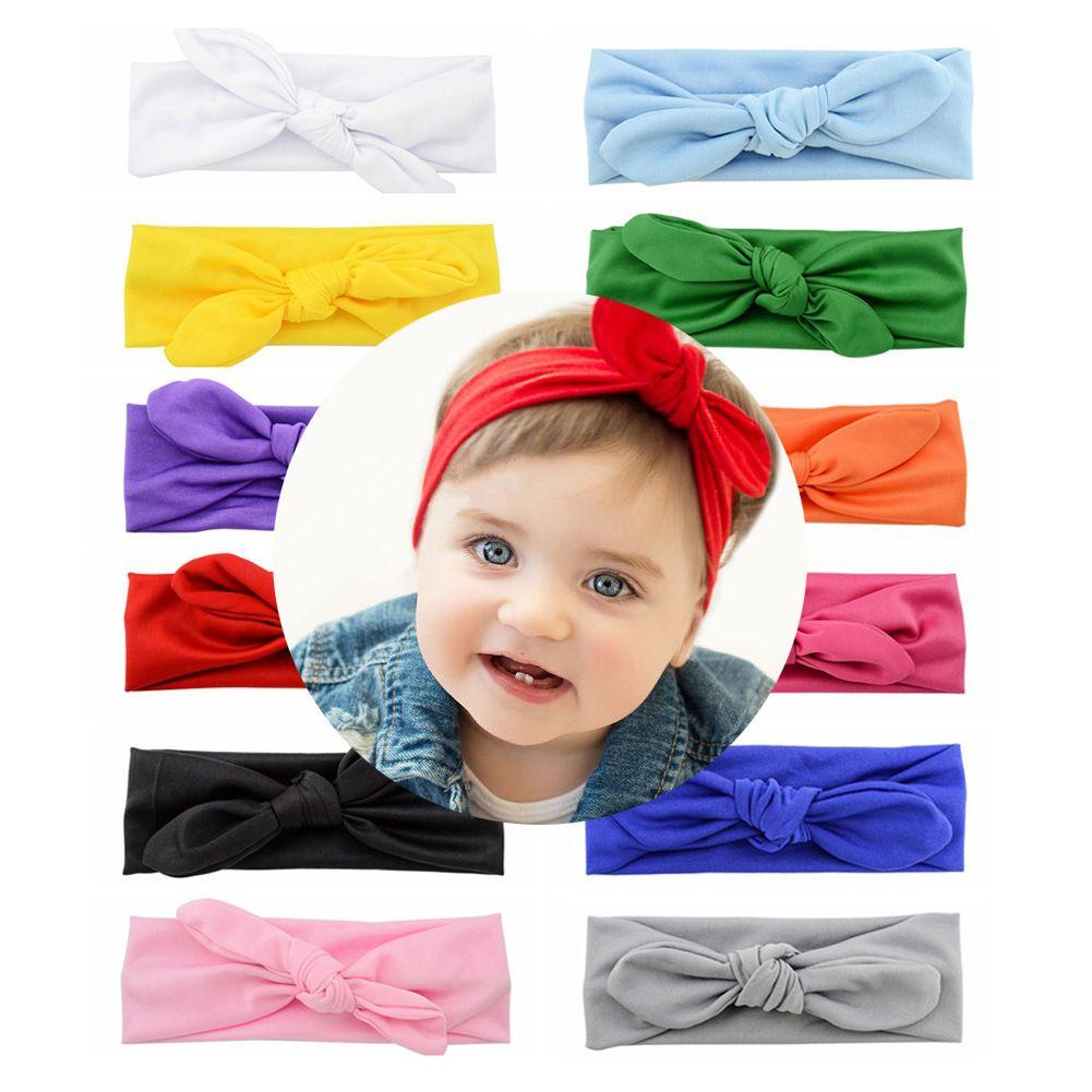 Conejo vendas del bebé del pelo de los niños colorido Banda bebé atado con nudos arco Venda principal elástico sólido Niños Headwear Boutique recién nacido turbante M1370