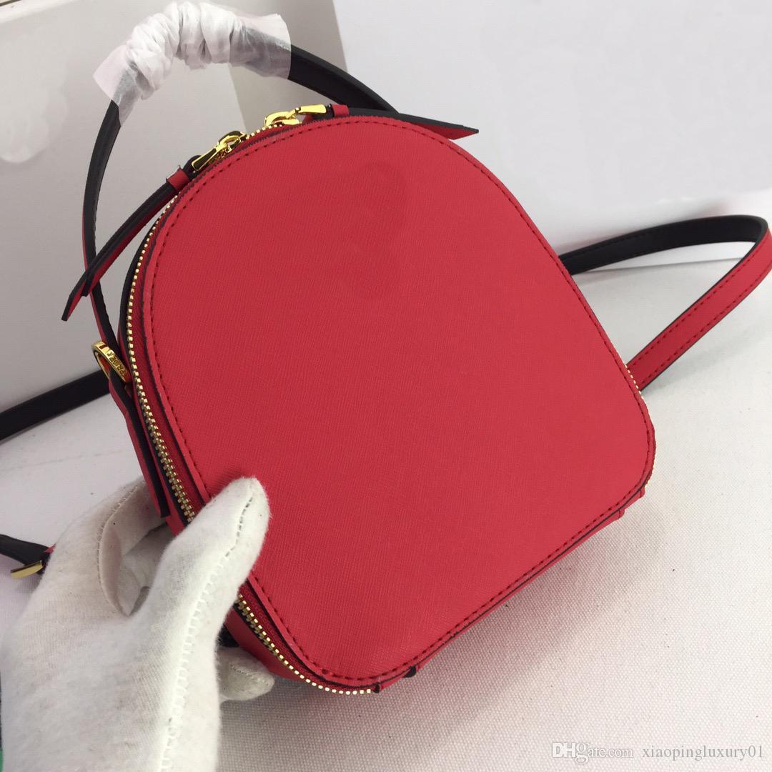leuchtend rote Farbe elegantes echtes Leder mit Doppelgürtel Temperament Dame Umhängetaschen England Rucksack mit Box mittlerer Größe