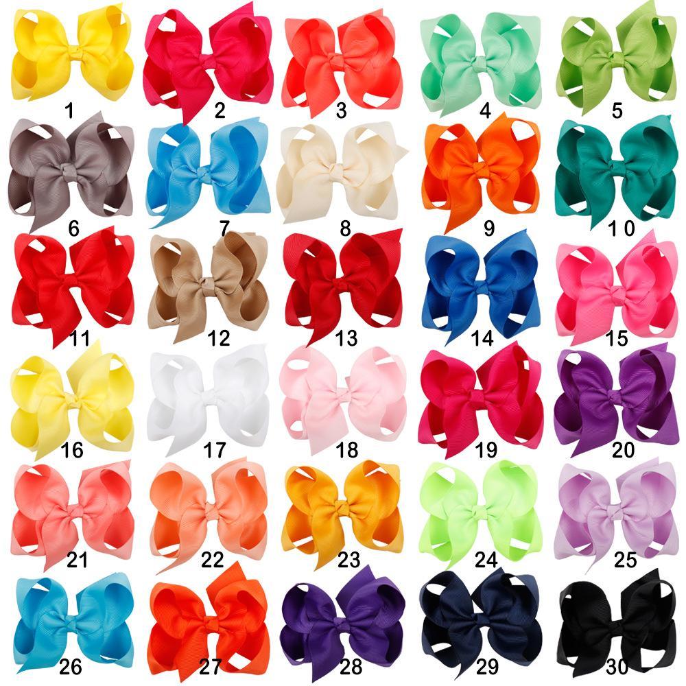 30PCS / الكثير 4 بوصة الصلبة القوس الشعر مع كليب بنات grosgrain الشريط Hairbows بوتيك اليدوية دبوس الشعر للاكسسوارات الشعر للأطفال