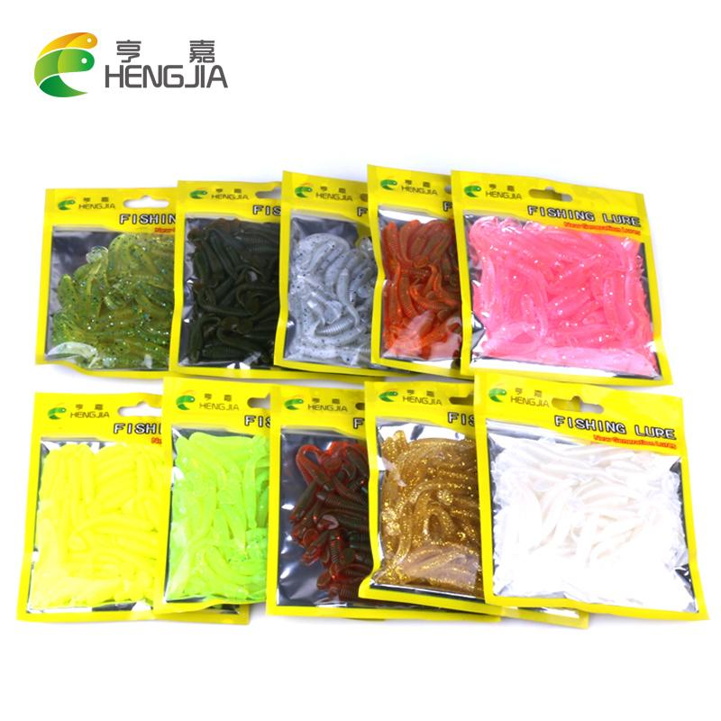Hengjia 50pcs fake bait Soft floating T fish Bionic isca Artificial fishing Lure fly fishing silicone bait Worms Shad Bass Y18101002