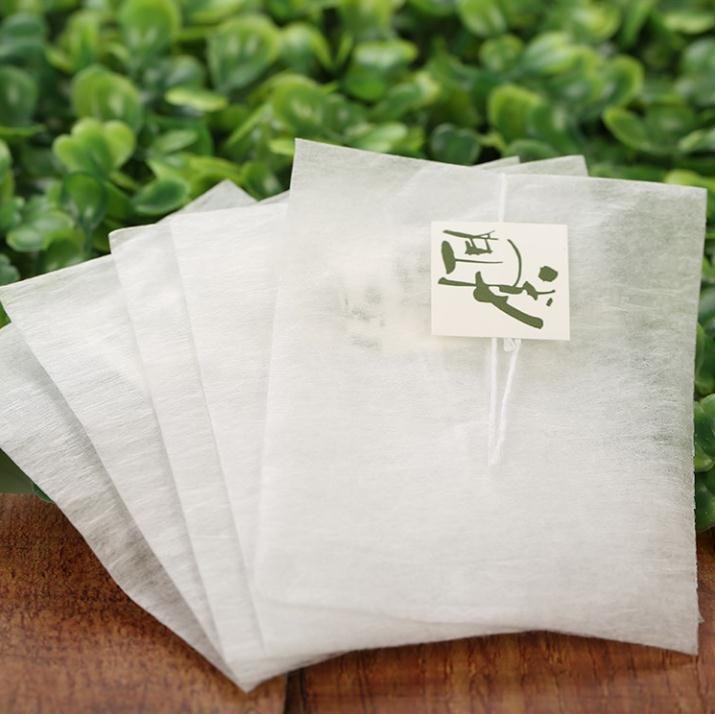 5.8 * 7cm وتسمية الذرة الألياف الشاي حقائب الهرم شكل حرارة ختم تصفية أكياس الشاي PLA Biodegraded الشاي فلاتر DHL