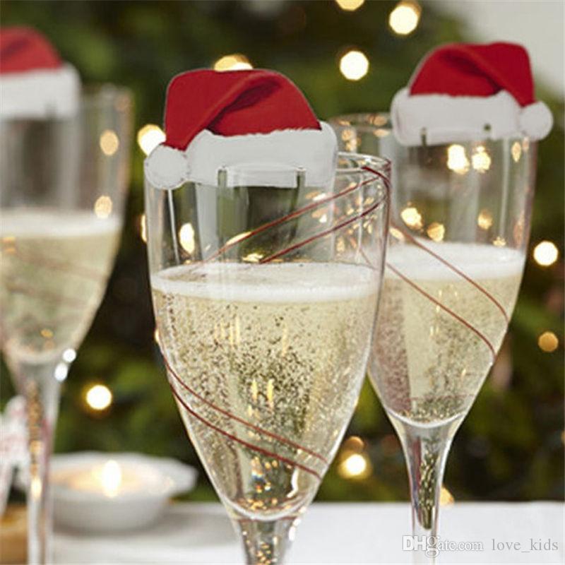 DHL 10 Adet / grup Noel Süslemeleri Ev Masa Yer Kartları Için Noel Santa Şapka Şarap Cam Dekorasyon Yeni Yıl Partisi Malzemeleri