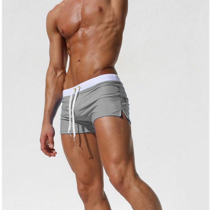 Homens Moda Swimwear 2020 Designer Swimming Trunks Homens cor sólida bolso de trás Swim Briefs Boxers Mens respirável Marca de roupa por atacado