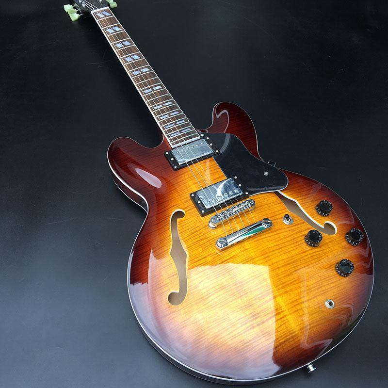 شبه جوفاء الجاز الغيتار الكهربائي، يتقوس أعلى الغيتار اللون 3TS شفاف، على الوجهين القيقب لهب أعلى، والكروم مطلي الأجهزة، مجاني مجانا