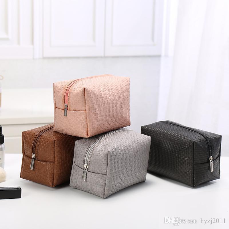 OLOEY Elegante y simple bolsa de cosméticos. Bolsa de lavado unisex. Bolsa de cremallera. Cuero de PU tejido. Entrega gratuita.