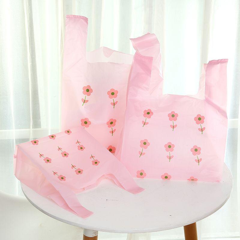 Gilet d'emballage 50pcs fleur Sacs détail Sacs à provisions en plastique Faveur de mariage sac-cadeau bonbons gâteau Emballage Sac de soirée de mariage Favor