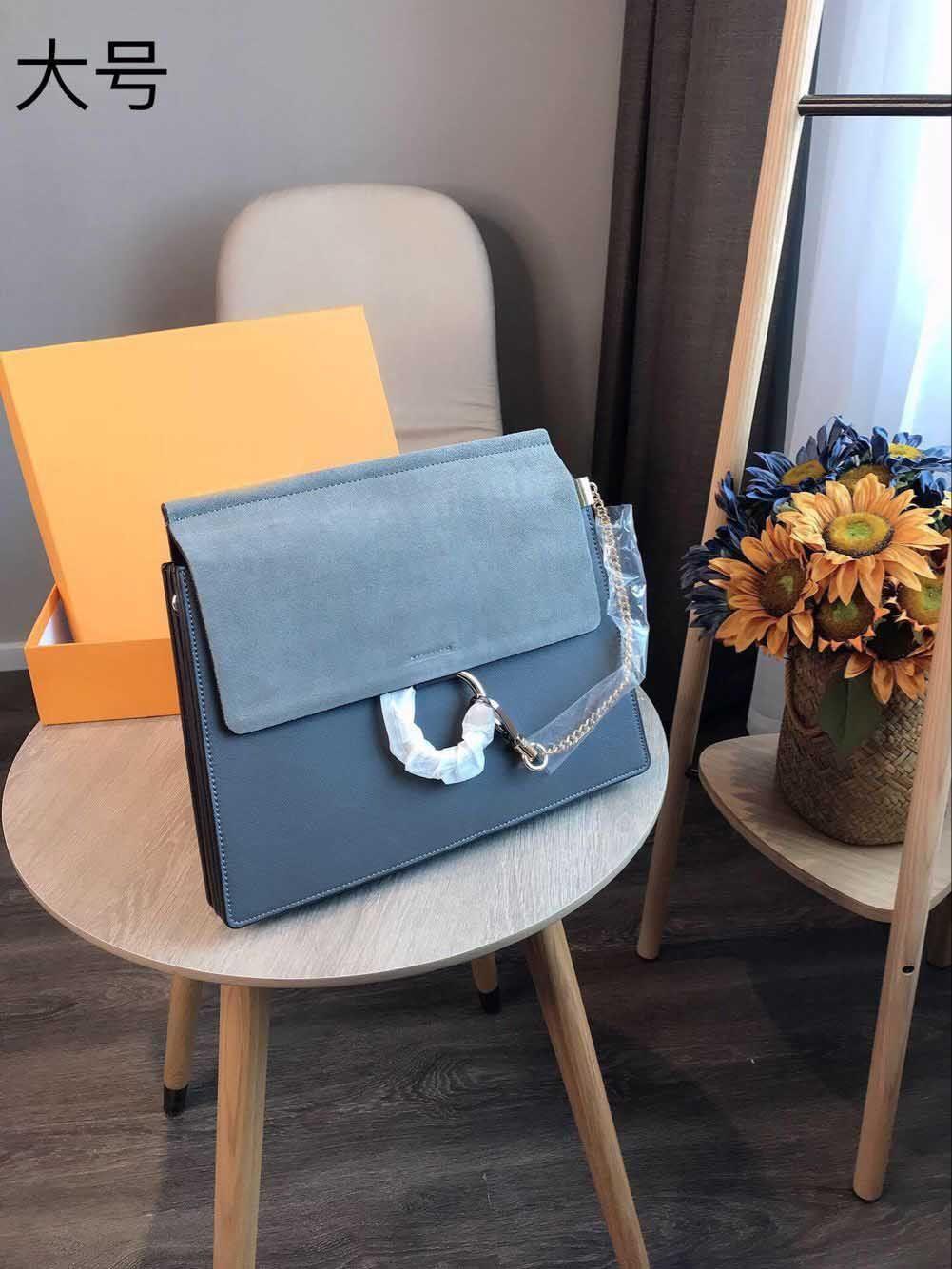 Omuz çantaları kadın lüks tasarımcı gerçek deri zincir crossbody çanta çanta ünlü daire tasarımcı çanta yüksek kalite büyük boy 31 cm