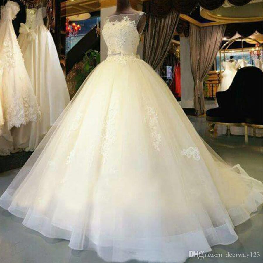 2018 Beautiful A-Line Sleeveless Tulle Wedding Dresses Illusion Neckline Appliques Elegnat Bridal Gowns Custom Made Court Train