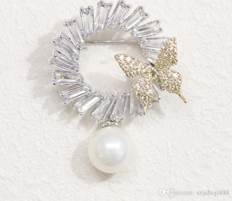 Papillon imitation perle de pierre incrusté tempérament de broche en pierre simple mais élégant avec broche femelle