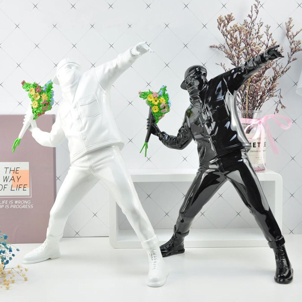 Escultura blanca de la calle británico negro / Boy creativo estatua flor del arte bombardero regalo miniatura de piedra Colección de Arte juguete Adornos