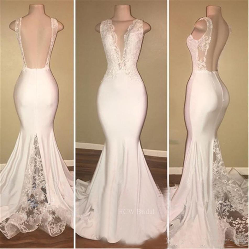 2018 New White Mermaid Prom Dresses Lungo abito da sera formale Backless profondo scollo a V Sweep treno pizzo abiti arabi sexy su misura