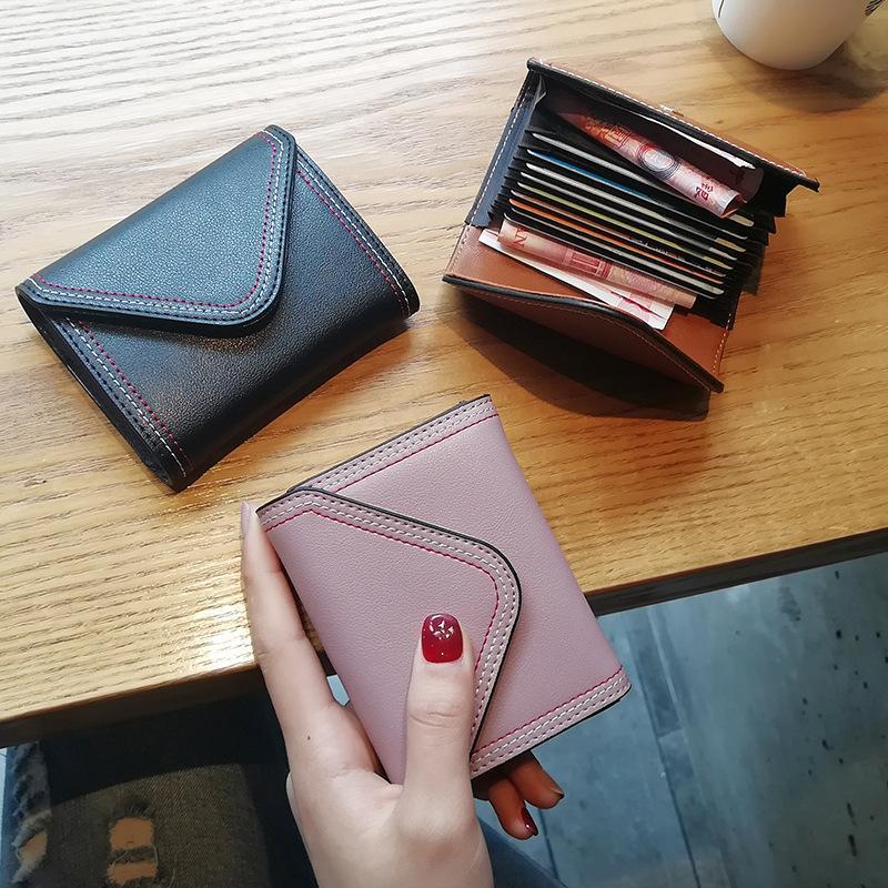 Nouveau Titulaire de la carte en cuir de vachette en cuir femmes ID de passeport carte de visite carte de visite sacs à main designer de mode sac à main court portefeuille libre