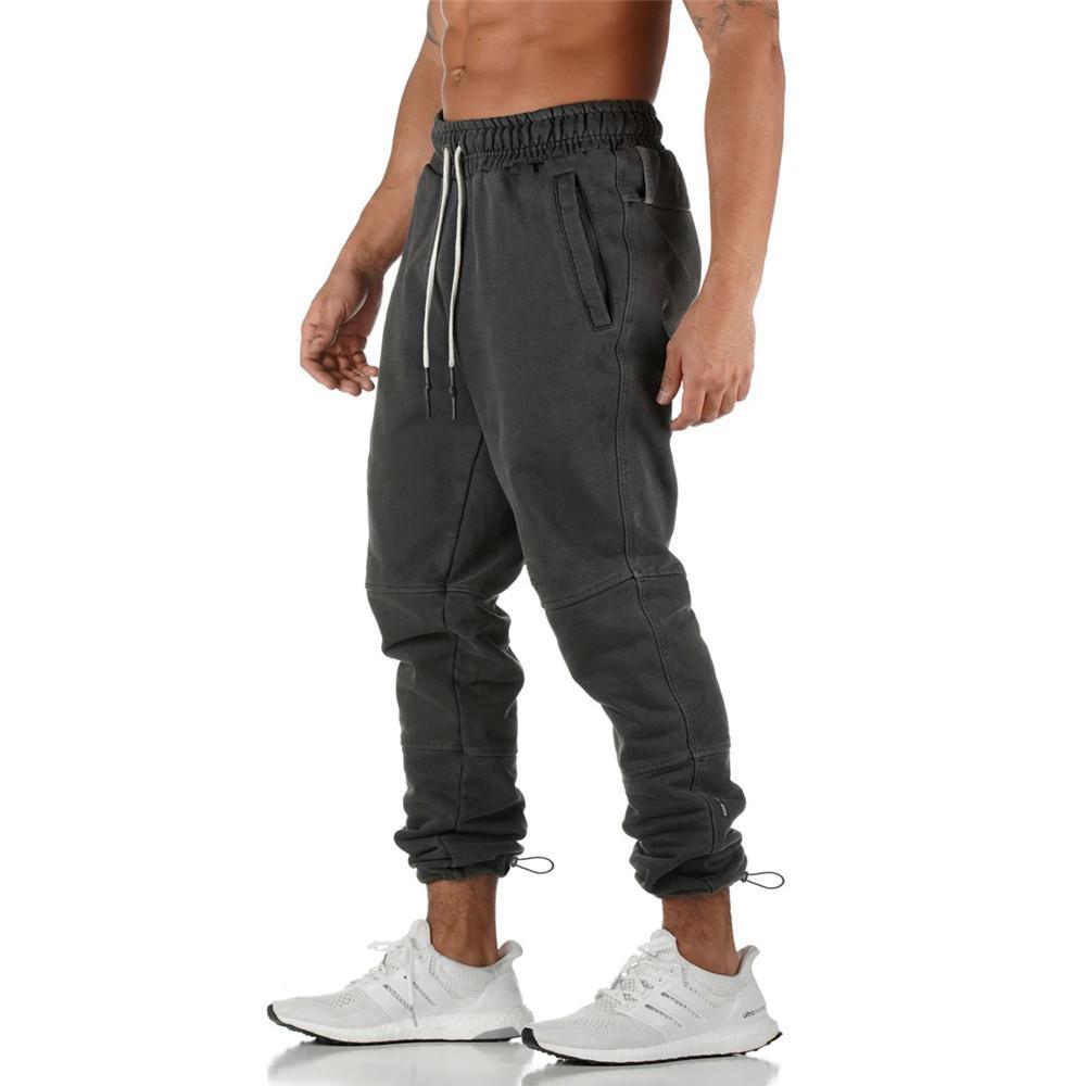 Sólidos Casual Calças calças Corredores Sweatpants Homens Gym Fitness Pista de algodão de Nova masculino Correr Desporto Calças Sportswear Calças Lápis T200324