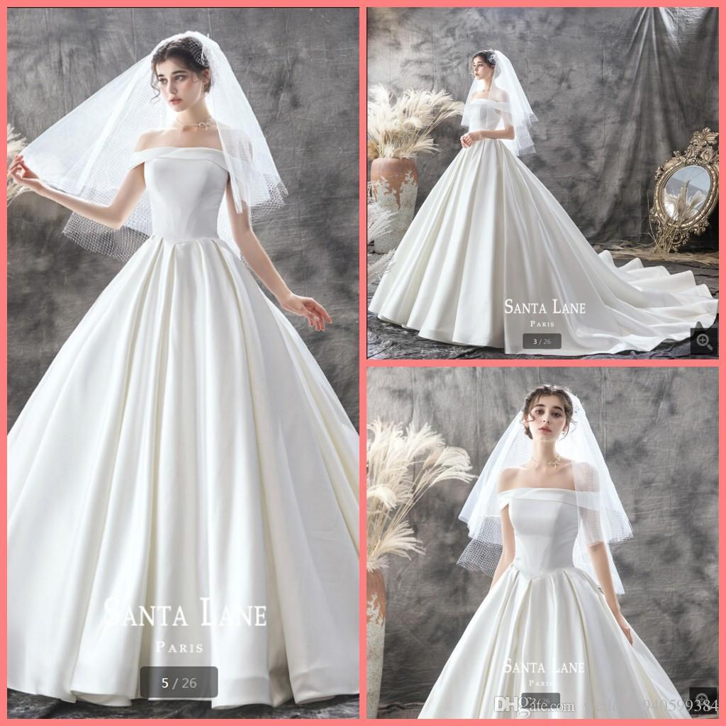 Robe де Mariage 2019 новый дизайнер белый атлас бальное платье свадебное платье от плеча с коротким рукавом принцессы опухшее долго невесты платья горячей продажи