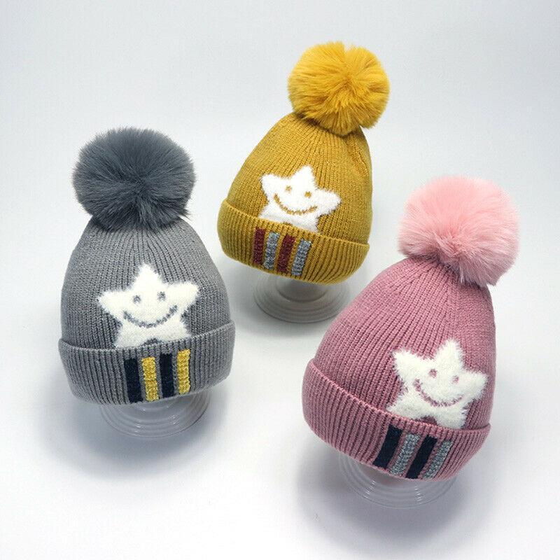Enfants d'hiver Bébé Fille Garçon Enfants chaud Mignon visage souriant imprimé étoiles Knitting Bonnet réel fourrure de raton laveur Fluffy balle Bobble Pom Hat