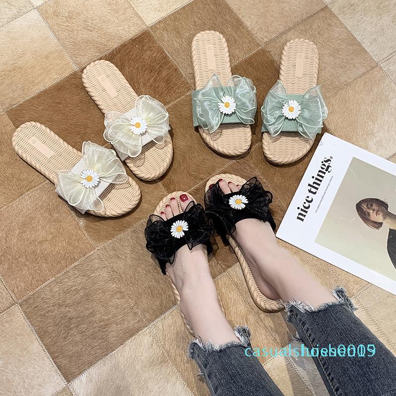 Verão 2020 designer de luxo novo arco chinelos pequenas daisy fresco planas fêmea selvagem lazer ao ar livre palavra da moda de fadas sandálias c09 L15