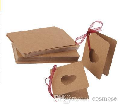 Etiqueta de la tarjeta del papel de regalo Etiqueta de la caída de papel Kraft con la cuerda roja Hollow Forma de corazón Lable para la boda Decoración de cumpleaños 300 unids