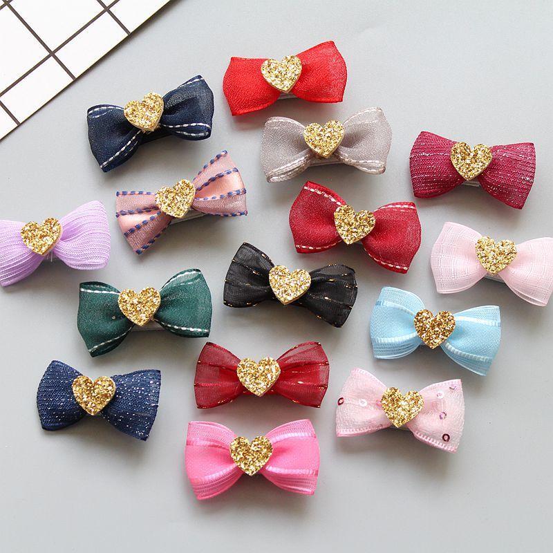 Boutique 60pcs moda linda del corazón del brillo del arco de las horquillas Solid Clips gasa del Bowknot del pelo de la princesa de Headware Accesorios para el cabello