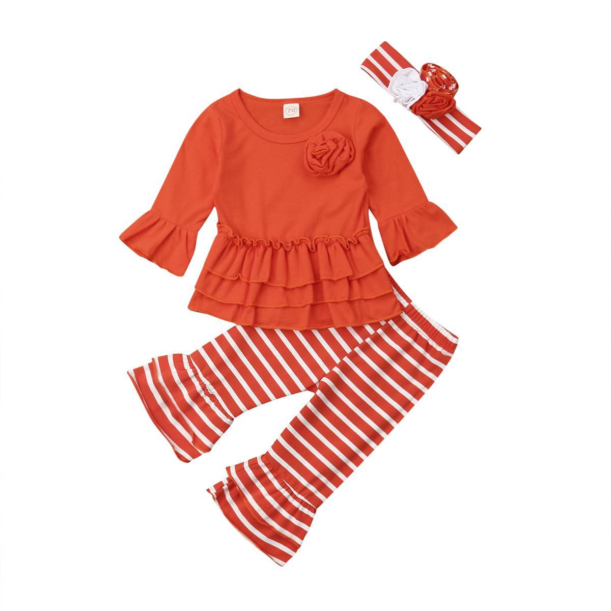 Jolie fleur Bébés filles Vêtements Nouvel An enfant en bas âge à manches longues solide Pull Haut + Pantalon long Flare Stripe + Hairband enfants Outfit