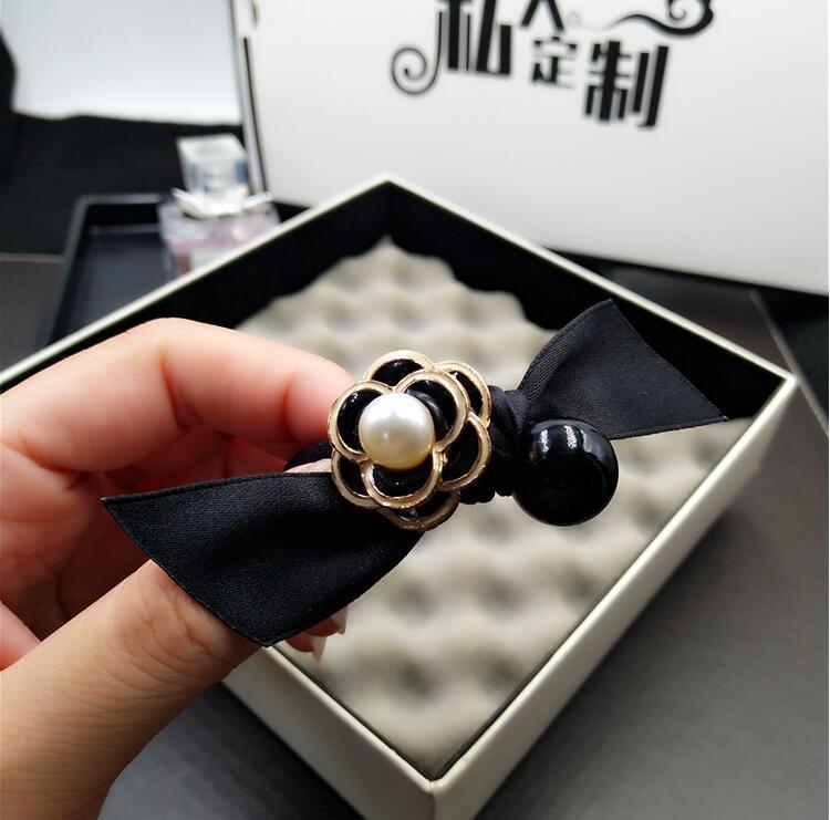 Мода Корея простая черно-белой камелии волос веревка лук ткани волосы кольцо головы канат жемчужного мяч голова галстук ребро резинка