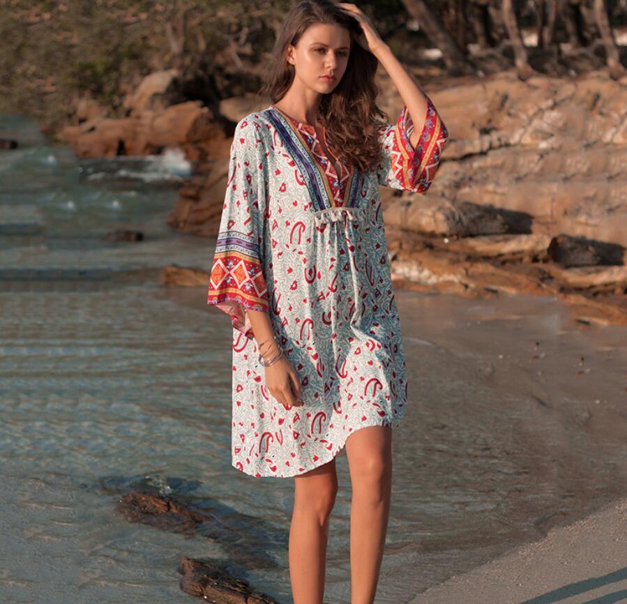 мода женщина женская одежда новая весна 2019 женская одежда девять минут рукав V-воротник легко нации печати платье средней юбки платья