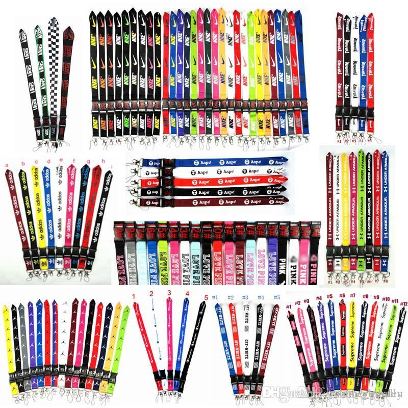 2020 الجملة الجديدة أكثر من 100 أنماط الحبل الأسود / الأزرق / أبيض 20 الألوان المتوفرة الشريط لجميع الهواتف المحمولة الساخن بيع سلسلة حزام الرقبة