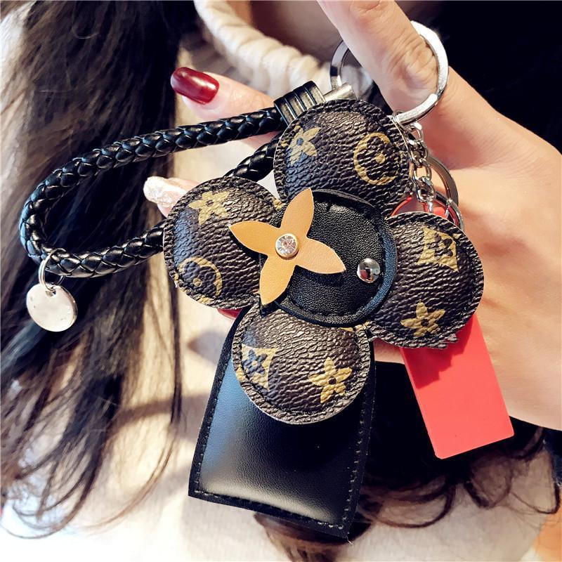 يوم الجمعة الأسود موضة Keychians السيارة للمرأة عالية الجودة المصنعية جلدية تريند Keychians الإبداعية زهرة الشمس سلسلة المفاتيح المعلقات