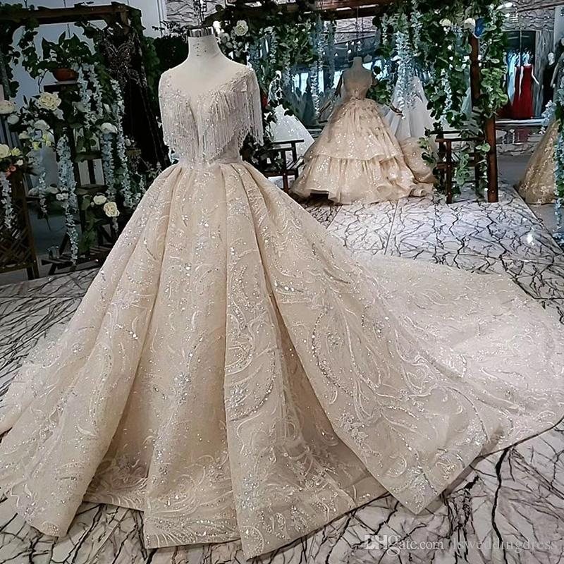 2019 Latest Lebanon Wedding Dresses Illusion O Neck Beaded Chest Short Sleeve Open Keyhole Lace Up Back Sequins Crystal Bridal Gowns Beach