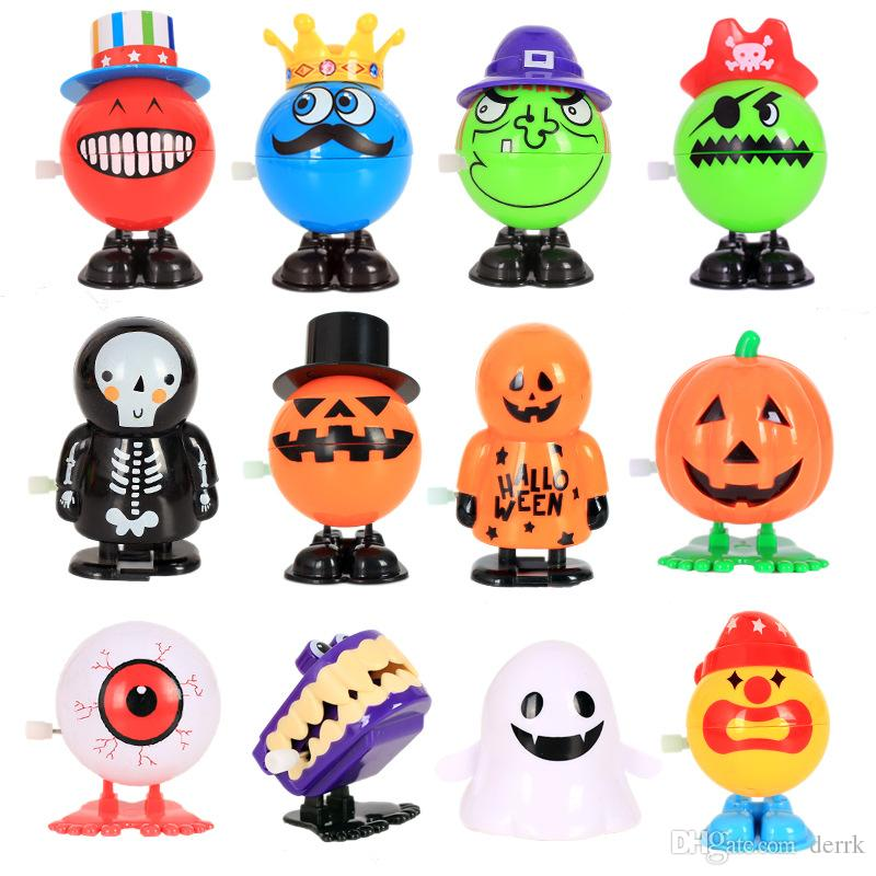 8 stili Jumping Halloween Wind-up Toy Funny PVC Pumpkins Ghost Skull Smile Face Doll Giocattoli Giocattoli per bambini Regalo di Halloween