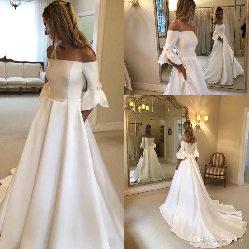 Sencillos vestidos de boda de la vendimia del botón del hombro media manga tribunal Satén cubierto Vestidos de novia Una línea Vestidos de boda con el bolsillo