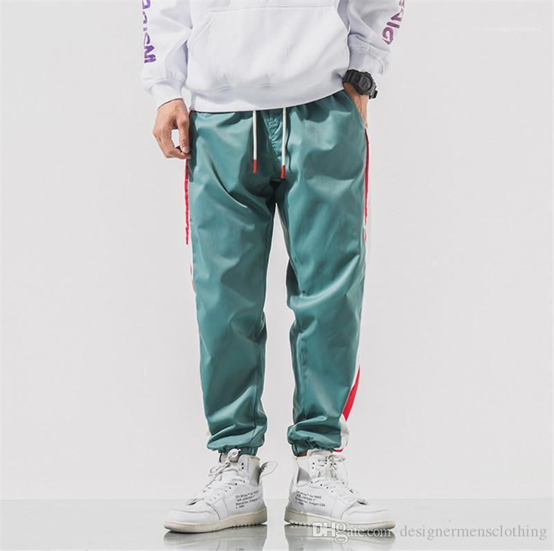 Lungo Mens matita pantaloni di modo coulisse Mens pantaloni a righe Lettera Mens del progettista dei pantaloni di colore Patchwork Sport allentati