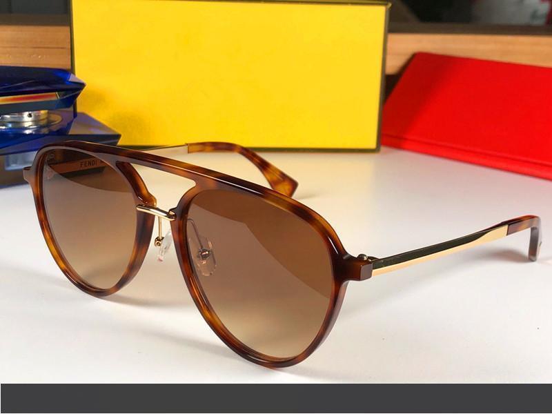 Gafas de sol de lujo 0105 del diseñador para las mujeres del marco Sun de la manera óvalo de cristal Piernas capa de espejo de la lente UV400 de fibra de carbono del estilo del verano Gafas