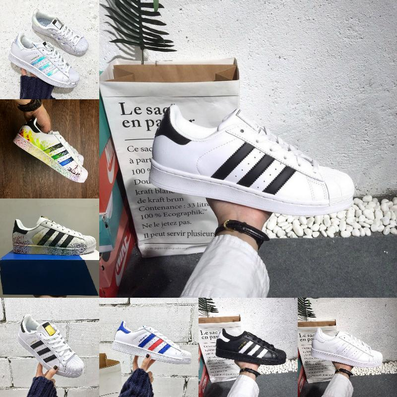 مبيعات النجوم الرجال أحذية رخيصة جديد أسود الذهب الأبيض الهولوغرام أصول جديد أحذية 80S الكبرياء أحذية رياضية سوبر ستار في الهواء الطلق النساء الرجال المشي
