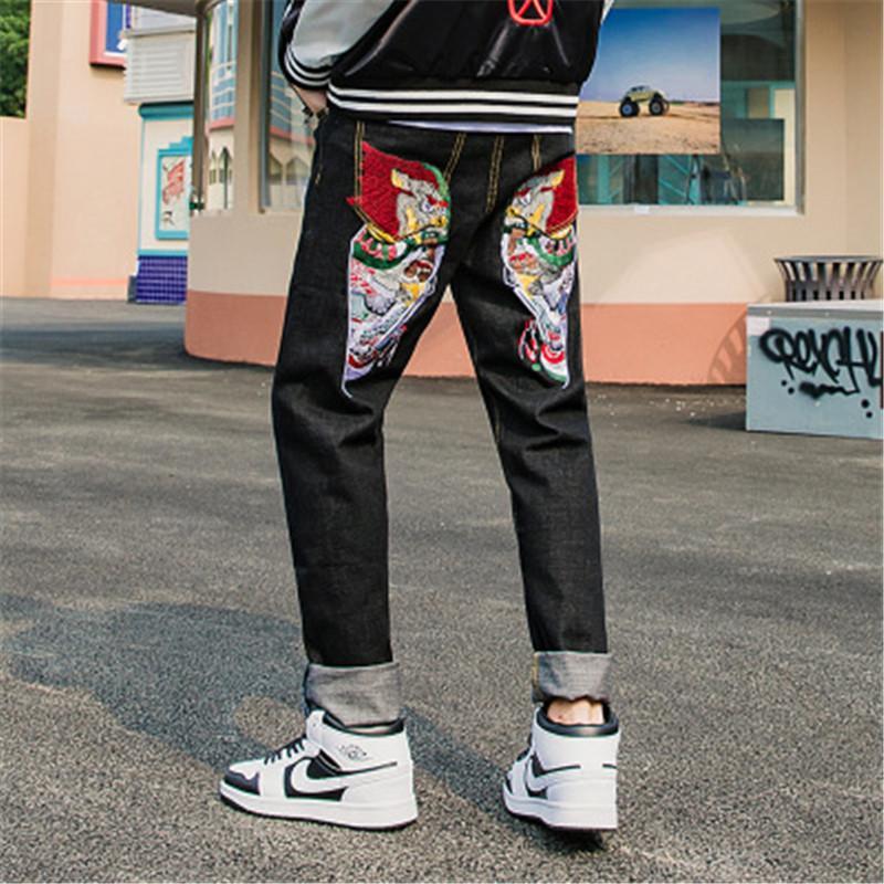 2019 العلامة التجارية الجديدة الخريف والشتاء رئيس العمل الوطني المد جينز الثقيلة التطريز الصينية نمط جينز للرجال سروال مستقيم الرجال