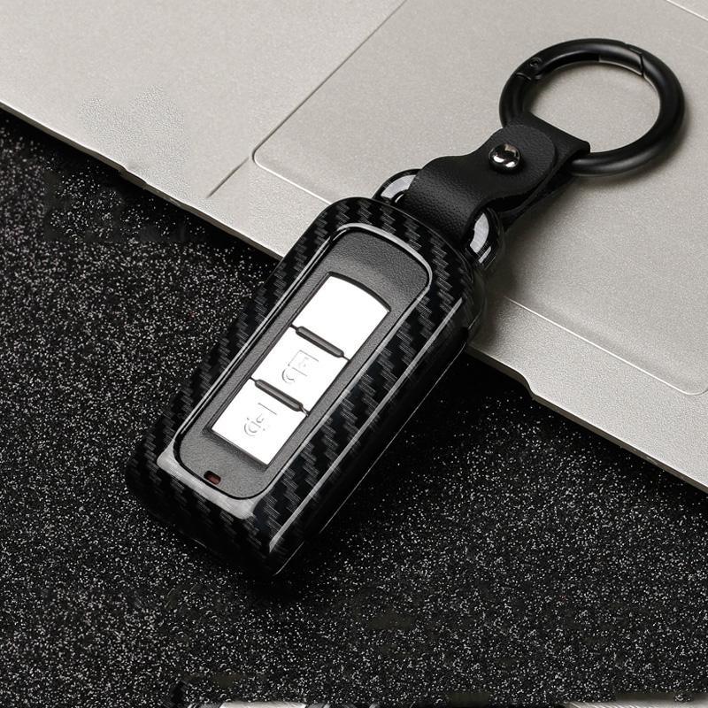 Caja dominante de la fibra de carbono de aleación de zinc cubierta del coche para Mitsubishi Lancer Outlander 10 Pajero Sport EX ASX Colt Grandis Accesorios L200