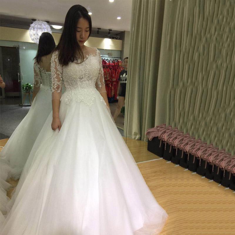 Новое прибытие Vintage Lace Pearls Свадебные платья 3/4 рукава тюль Свадебные платья Шнуровка развертки Поезд платья Длинные свадебные