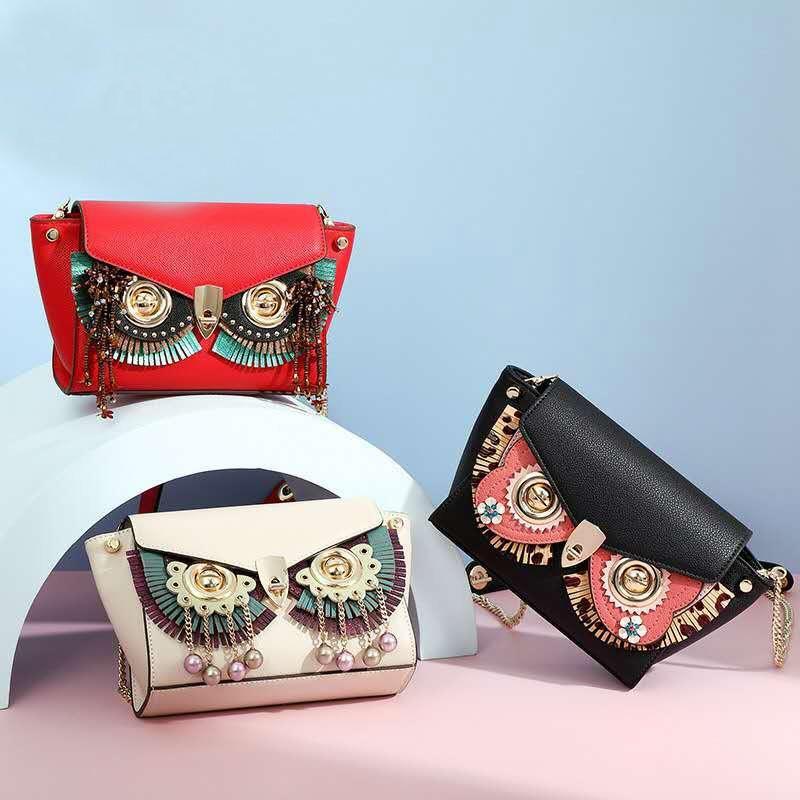 Design wing bag ladies fashion trendy wild diagonal shoulder bag personality owl mask face change simple female bag wholesale 80001