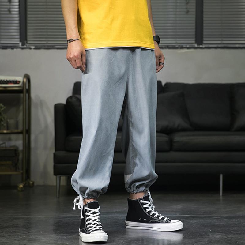 Mens 2020 Sólidos bolso calças soltas Múltiplas bolso da calça Urban Tacitcal Carga Pés Calças Men Slim Fat Feixe