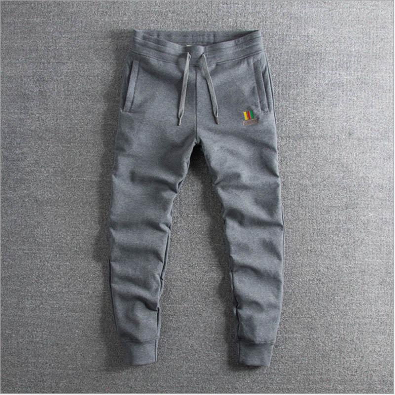 Весной и летом 2019 года новые вымытые водой хлопчатобумажные штаны с вышивкой для внешней торговли мужские штаны для досуга в продаже