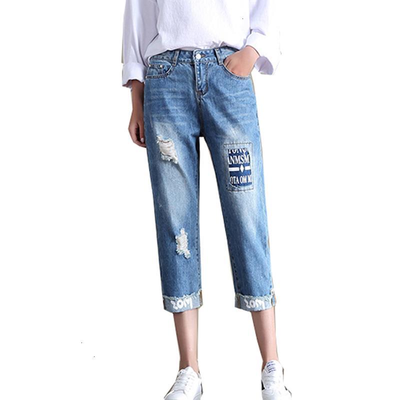Compre Sueltos Pantalones De Las Mujeres De La Moda De La Mujer Del Pelo De Las Nuevas Mujeres Roto Roto Pantalones Vaqueros Rasgados Pantorrilla De La Muchacha Del Estudiante Longitud Broek Ym825