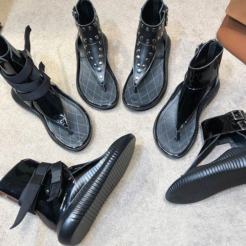 الفاخرة مصمم النساء الصنادل روما الأحذية برشام المصارع الأزياء عالية أعلى 100٪ جلد حقيقي أحذية الشاطئ المطاط وحيد