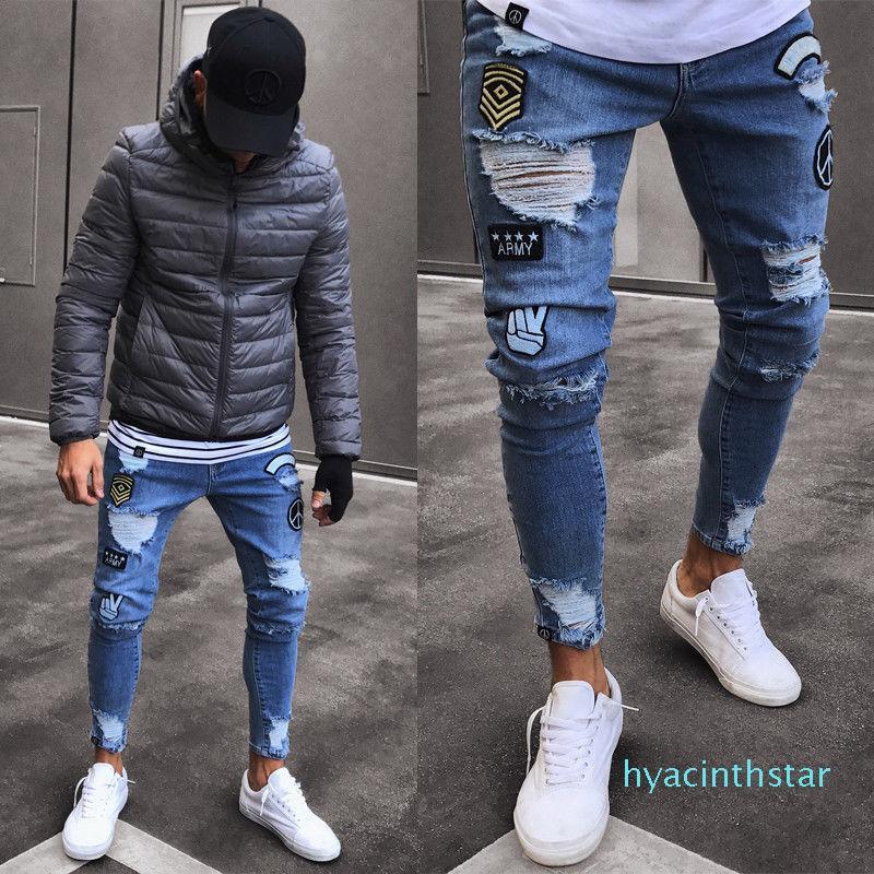 Мода мужские джинсы тощий Rip Тонкий Stretch Джинсовые дистресс Изношенные Байкер Джинсы Мальчики Вышитые Карандаш Брюки XM01