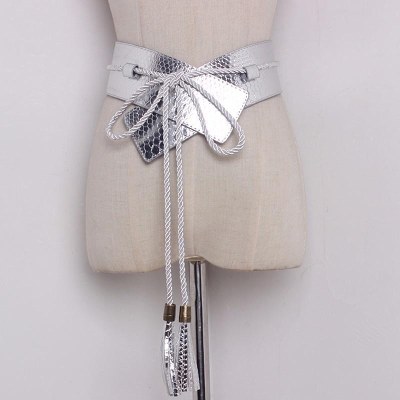 TWOTWINSTYLE PU cuir large ceinture pour les femmes Snakeskin Tassel Lace Up femmes Ceintures 2020 Printemps Cummerbund Mode New Y200501