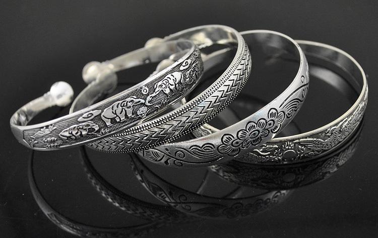Al por mayor-Nuevo estilo de plata tibetano de la manera del metal de la vendimia que talla brazaletes de puño brazaletes para las mujeres vestido de 11 diseños de Elección