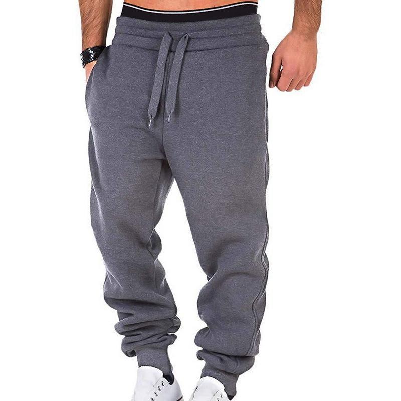 2020 Весна Мужчины Спорт бегающих Брюки Карманы Эластичность талией Брюки повседневные брюки для бега трусцой Sweatpants Solid T200612