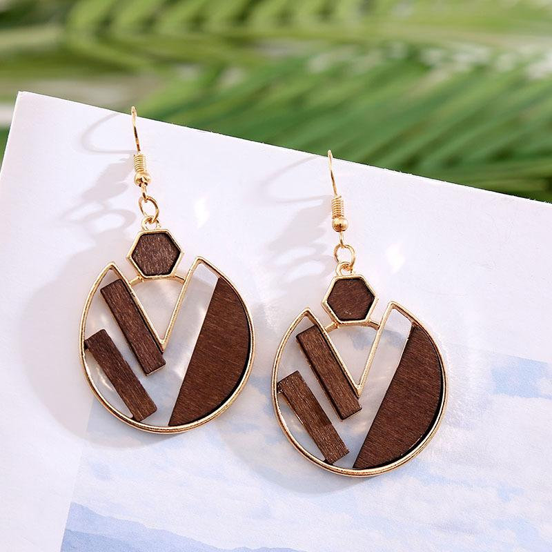 La nueva aleación exagerada de Europa y América femenina de madera geométricas redonda creativa pendientes de la joyería