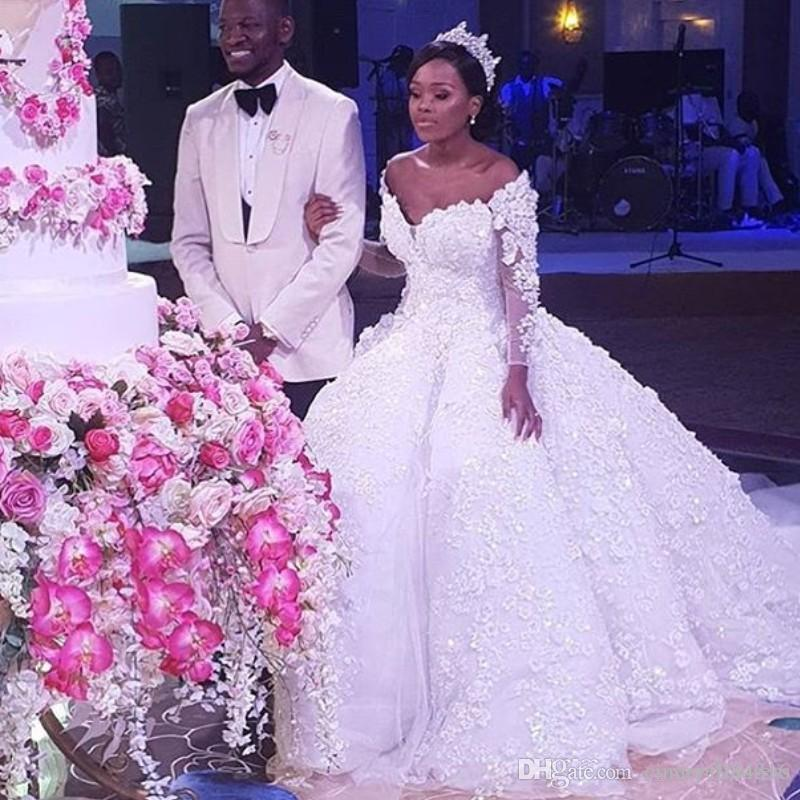 2020 Stunning Plus Size Wedding Dresses Handmade Flowers 3D Lace Applique Beaded Bridal Gowns Dubai African Crystal Tulle Wedding Gowns