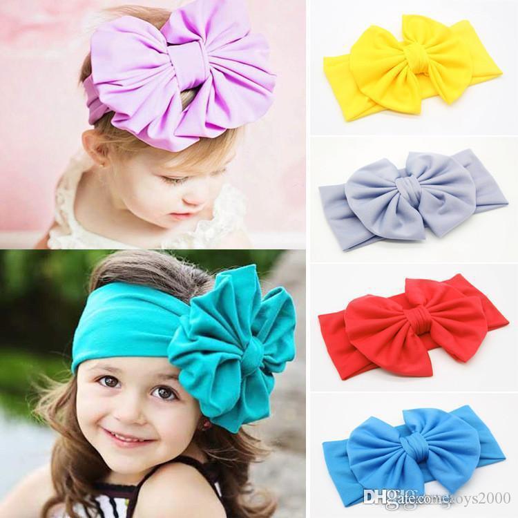 Neue Baby-Mädchen-Bogen-Stirnband-Europa-Art-große weite Bowknothaar Band 10 Farben Kind-Haar-Accessoires Kinder-Stirnband Haarreif