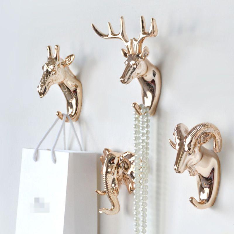 Animal en forma de moda Escudo Ganchos ciervos ciervos Rhino caballo jirafa elefante dirigen la pared Percha para sombrero sostenedor del gancho rack Decoración para el Hogar